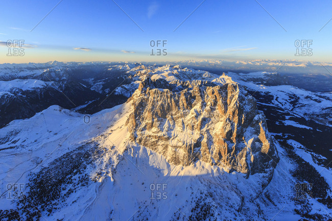 Aerial view of Sassolungo Sassopiatto and Grohmann peak at sunset. Dolomites Sella Group Trentino Alto Adige Italy Europe