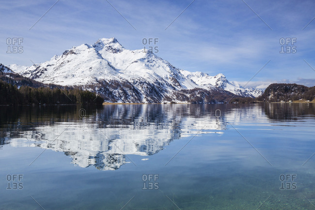 Piz da la Margna is reflected in the clear water of Lake Sils Maloja Pass Engadine Canton of Graubunden Switzerland Europe