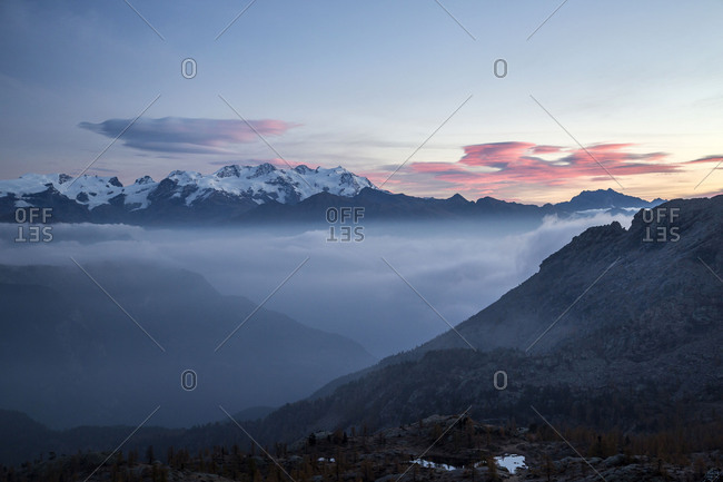 Sunrise on Matterhorn and Mount Rosa. Natural Park of Mont Avic. Valle d'Aosta Graian Alps Italy Europe