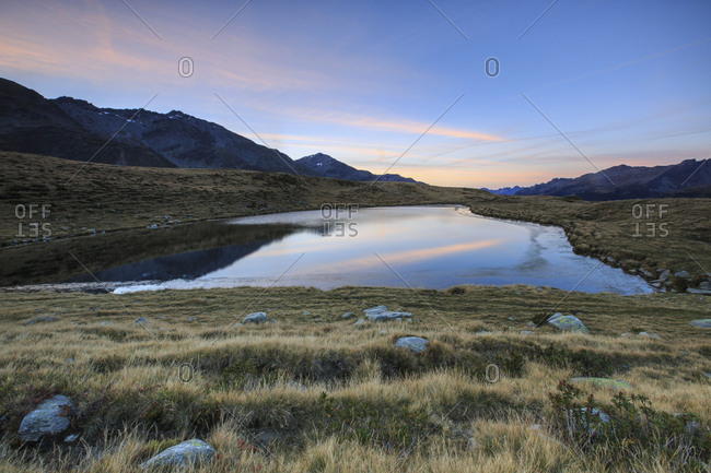 Autumnal view of Lake Andossi at sunrise Chiavenna Valley Spluga Valley Valtellina Lombardy Italy Europe