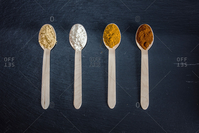 Local spices and aromas of Italian cooking stored in spoons