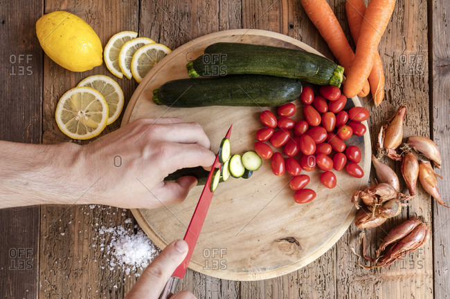 Chef cuts fresh vegetables essential ingredients of typical and healthy Italian cuisine