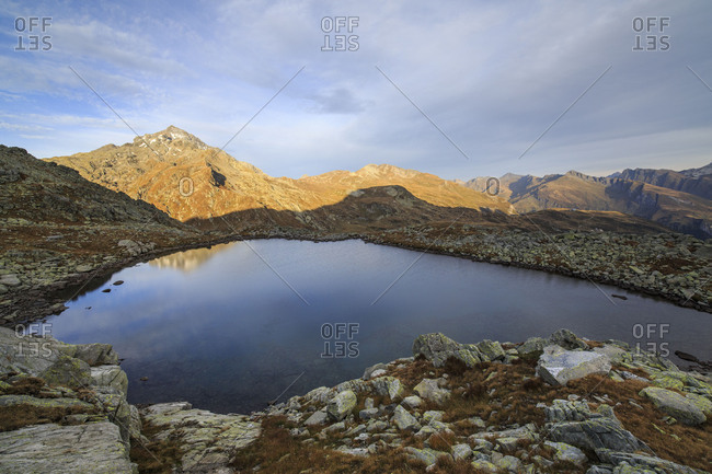 Peak Tambo reflected in Lake Bergsee at dawn Chiavenna Valley Spluga Valley Switzerland Europe