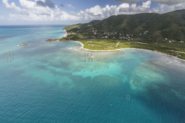 Aerial view of the turquoise caribbean sea and vegetation on the isle of Antigua Leeward Islands West Indies