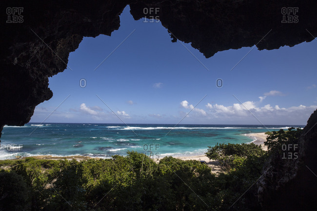 The turquoise caribbean sea seen from a  a grotto The Cave Barbuda Leeward Islands West Indies