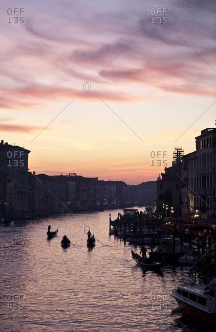 Gondolas along the Grand Canal at dawn Venice Veneto Italy Europe