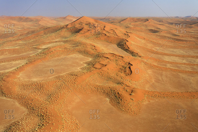 Aerial view of the sand dunes and typical plants in the dry landscape of Namib Desert Namibia Southern Africa