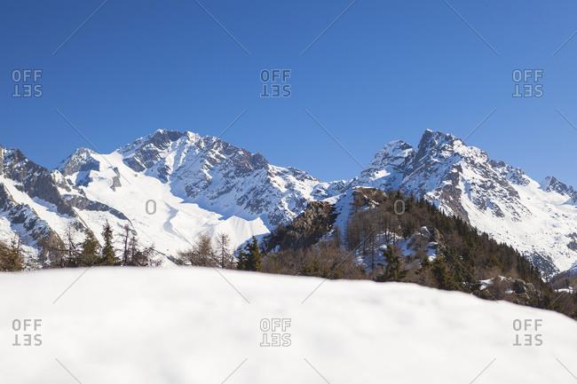 The snowy peak of Mount Disgrazia framed by blue sky Alpe Granda Sondrio province Masino Valley Valtellina Lombardy Italy Europe
