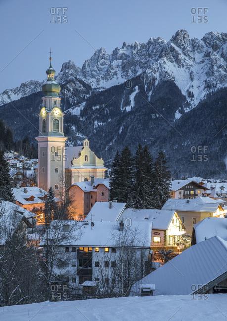 December 9, 2017: The village of Dobbiaco illuminated at the blue hour, Pusteria valley, dolomites, Trentino Alto Adige, Italy, Europe