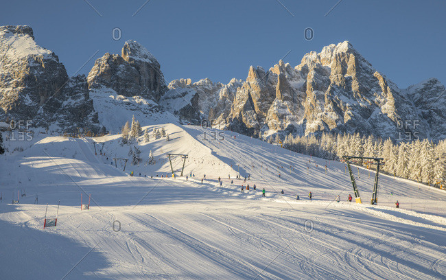 Skiing slopes at the Monte Croce Comelico Pass and in the background the dolomites of Sesto, Pusteria valley, Trentino Alto Adige,Italy