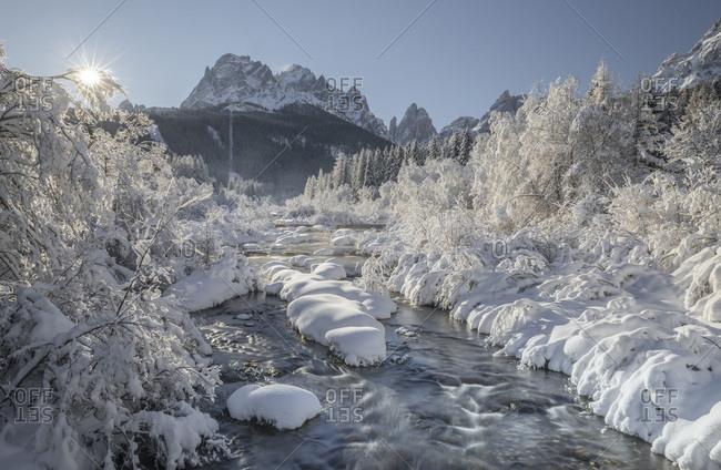 The snowy landscape of Moso, in the background the Sesto Sundial with the Croda dei Toni peaks, dolomites, Pusteria valley, Trentino Alto Adige, Italy, Europe