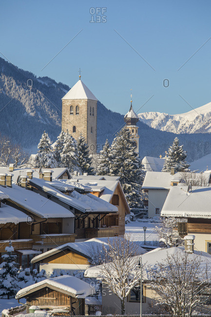 January 5, 2018: View over the roofs of San Candido with the Collegiata and the bell tower of the church of San Michele, Alta Pusteria, Trentino Alto Adige, Italy