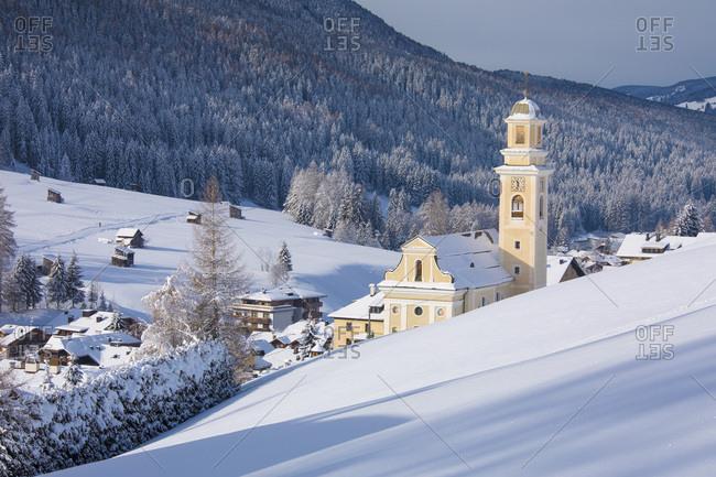 The church of Sesto' s village illuminated at the first light of morning, dolomites, Alta Pusteria valley, Trentino Alto Adige, Italy, Europe
