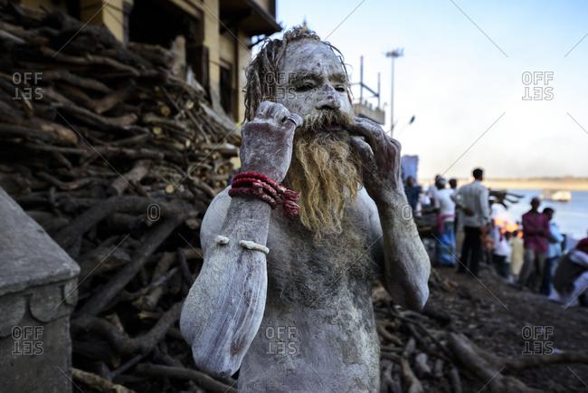 March 6, 2018: Sadhu, Holi man on the banks of the Ganges, Varanasi, Uttar Pradesh, India