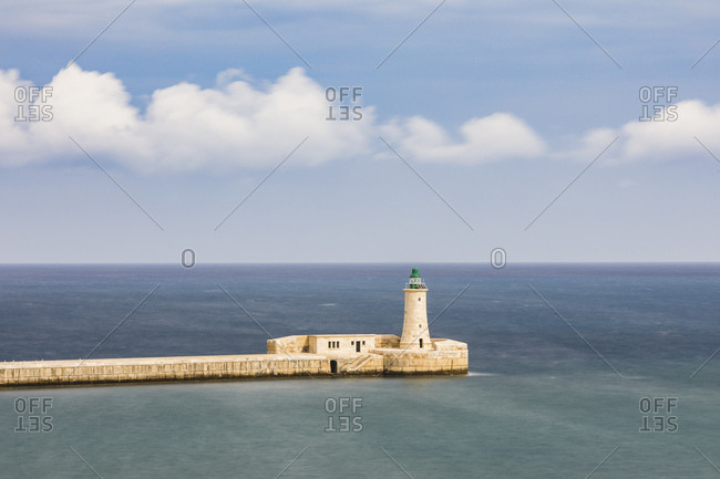 St. Elmo Breakwater Lighthouse, Grand Harbor, La Valletta, capital city of the island of Malta.