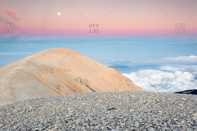 The moon rise over the Mount Acquaviva in the amphitheater of the Murelle, Majella national park, Abruzzo, Italy, Europe