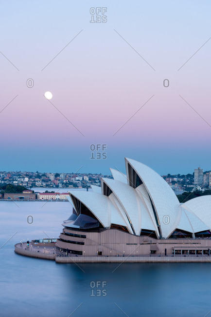July 27, 2018: Sydney opera house at sunset against colourful magenta sky