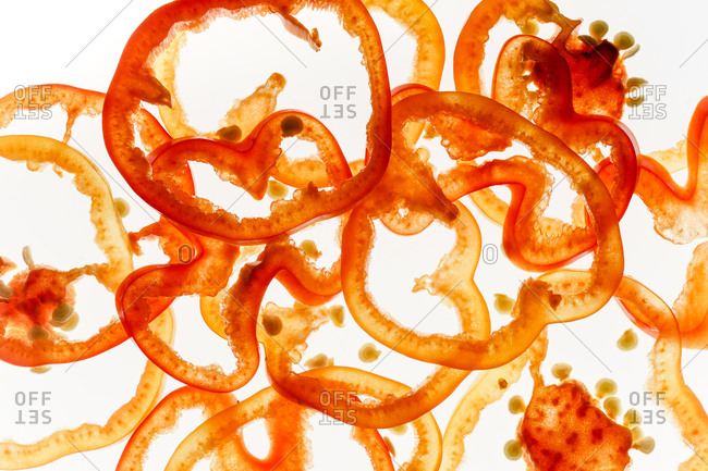 Maco image of red and yellow bell pepper slices on backlit background