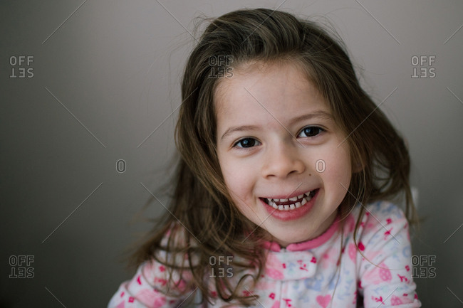 Portrait of a smiling girl with brown hair