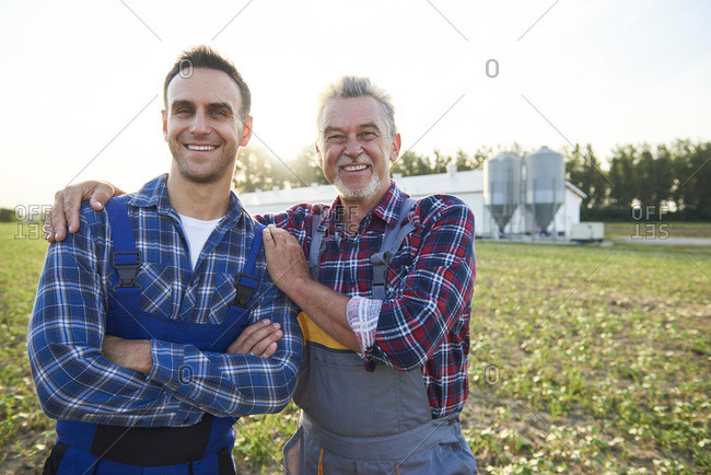 Portrait of two farmers proud of their farm