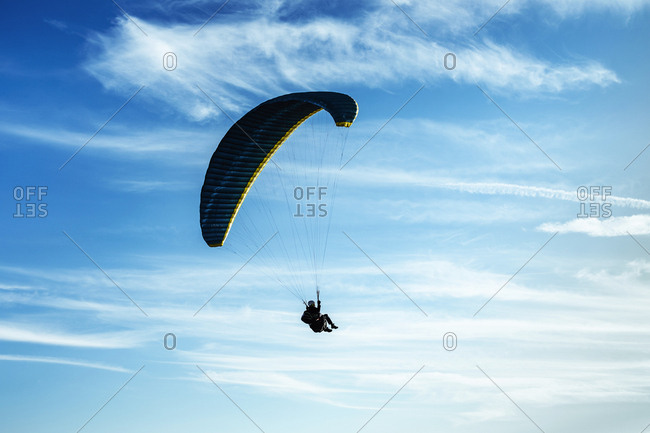 August 13, 2018: Paragliding- paraglider- blue sky with clouds in Spain