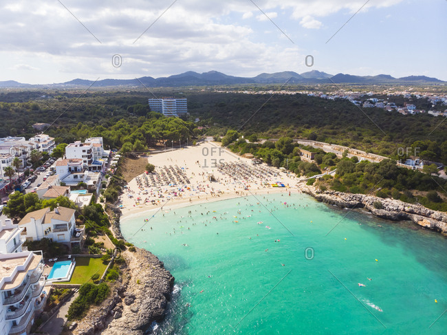 Spain- Mallorca- Portocolom- Aerial view of Punta des Jonc- Bay of Cala Marcal- beach with tourists