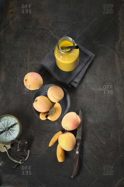 Fruit smoothie and ingredients- apples- apricots- mango and orange