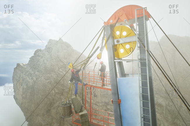 Germany- Bavaria- Garmisch-Partenkirchen- Zugspitze- installers working on goods cable lift