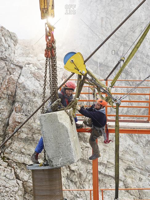 Germany- Bavaria- Garmisch-Partenkirchen- Zugspitze- installers working on goods cable lift