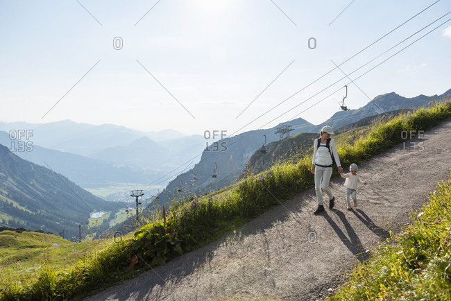 Germany- Bavaria- Oberstdorf- mother and little daughter on a hiking trip in the mountains