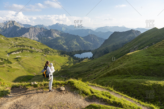 Germany- Bavaria- Oberstdorf- mother and little daughter on a hike in the mountains looking at view