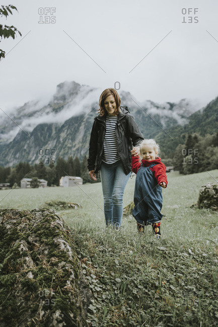 Austria- Vorarlberg- Mellau- mother and toddler on a trip in the mountains