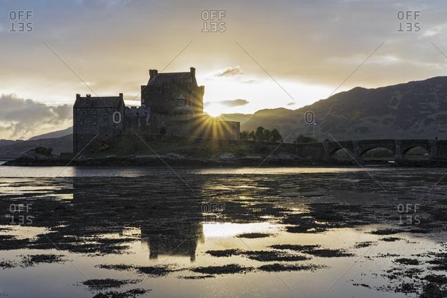 UK- Scotland- Dornie- Loch Duich- Eilean Donan Castle at sunset