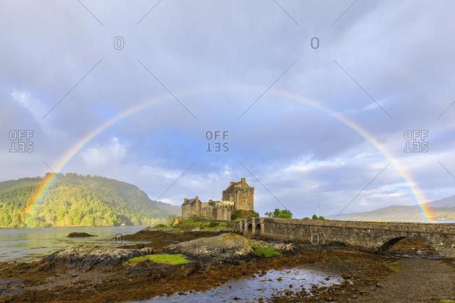 UK- Scotland- Dornie- Loch Duich- Eilean Donan Castle with rainbow