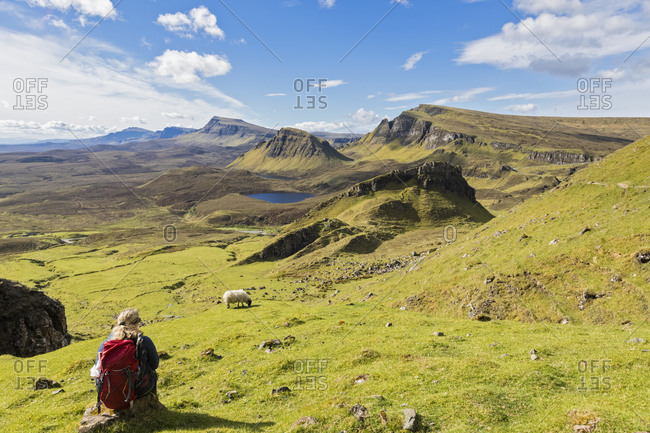 UK- Scotland- Inner Hebrides- Isle of Skye- Trotternish- Quiraing- hiker looking towards Loch Cleat