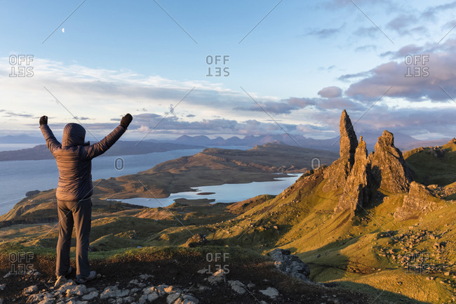 UK- Scotland- Inner Hebrides- Isle of Skye- Trotternish- tourist on peak near The Storr