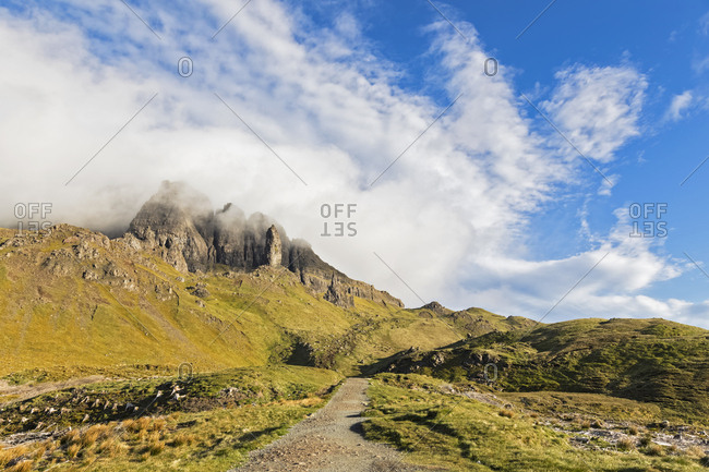 UK- Scotland- Inner Hebrides- Isle of Skye- Trotternish- clouds around The Storr- trail towards observation point