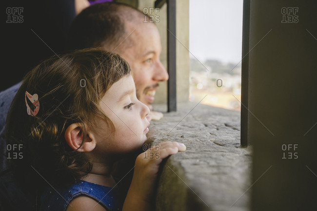 Czechia- Prague- little girl and her father looking at view from the old town hall