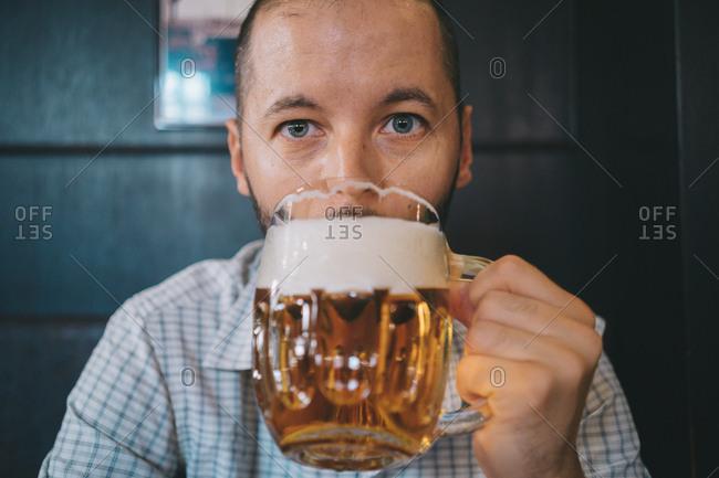 Czechia- portrait of man drinking beer in a pub