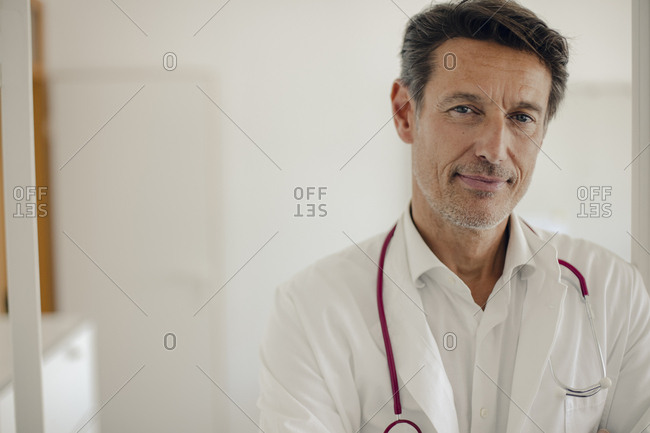 Doctor standing in hospital with stethoscope around neck- portrait