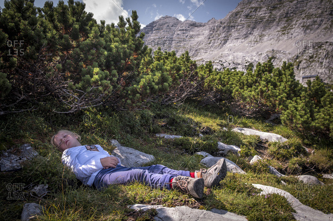 Austria- Salzburg State- Loferer Steinberge- girl resting on a hiking trip in the mountains