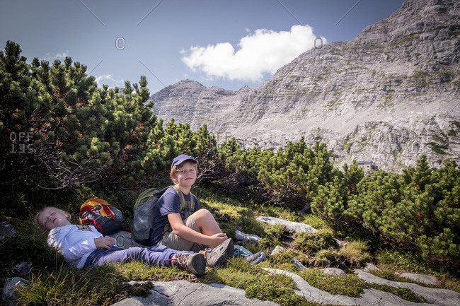 Austria- Salzburg State- Loferer Steinberge- brother and sister resting on a hiking trip in the mountains