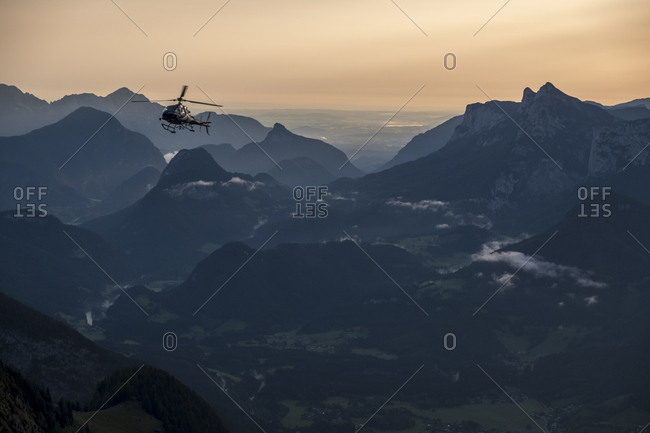 Austria- Salzburg State- Loferer Steinberge- helicopter in mountainscape at twilight