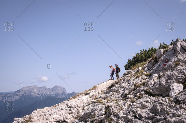 Austria- Salzburg State- Loferer Steinberge- brother and sister on a hiking trip in the mountains
