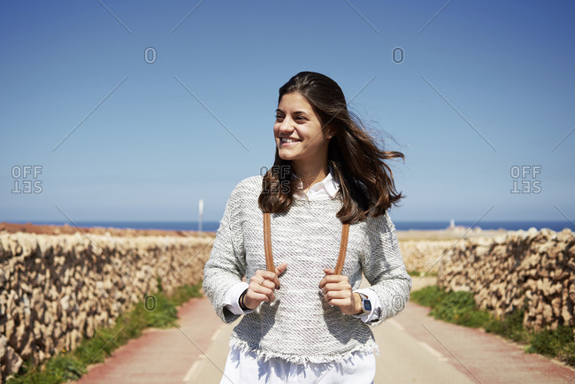 Young smiling brunette woman outdoors