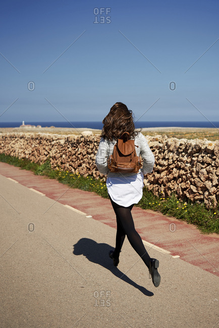 Young brunette woman running outdoor