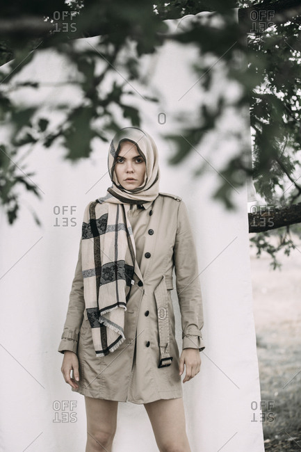 Portrait of fashionable young woman wearing coat and scarf