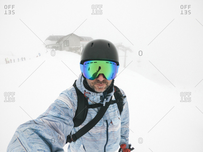 Italy- Modena- Cimone- portrait of man wearing ski goggles and helmet in haze