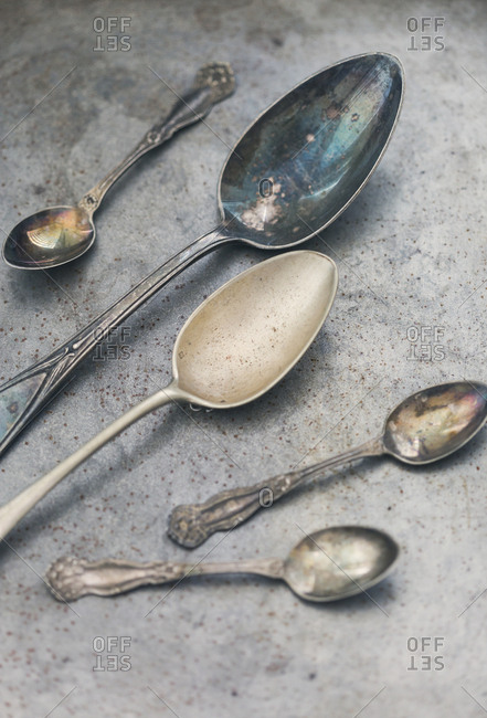 Old spoons on metal