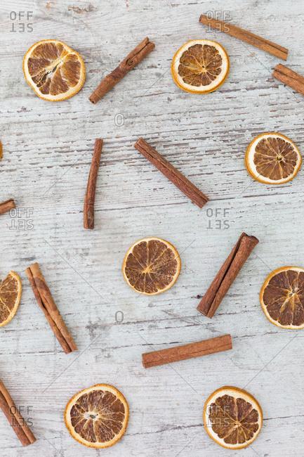 Dried orange slices and cinnamon sticks on wood